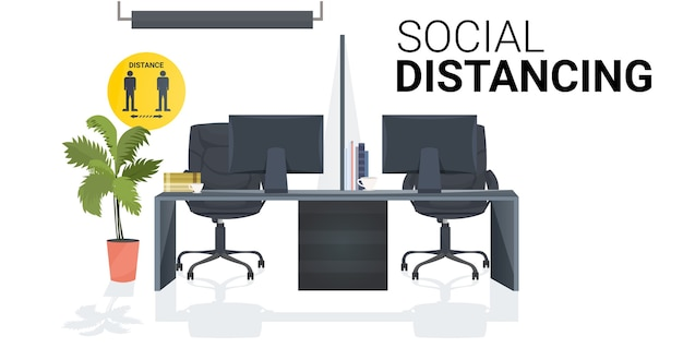 Workplace desk with sign for social distancing yellow sticker coronavirus epidemic protection measures office interior horizontal