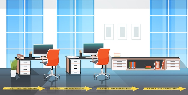 Workplace desks with signs for social distancing yellow stickers coronavirus epidemic protection