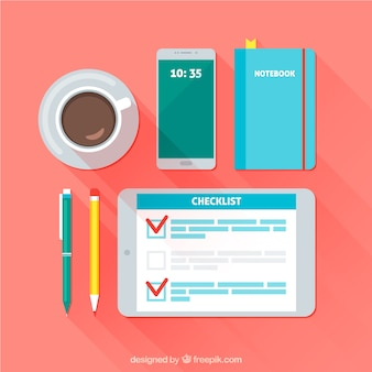 Workspace background with checklist, coffee cup and other decorative items