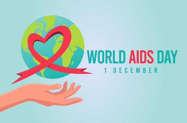 地球上のエイズ意識の赤いリボンが付いた世界エイズデー