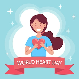 World heart day, smiling person holds a red heart in her hands