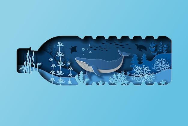 Концепция всемирного дня океанов синий кит в бутылке воды