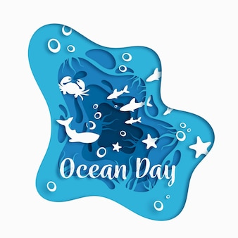 World oceans day in paper style with fish