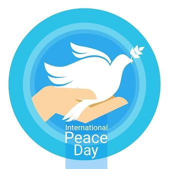 손바닥에 세계 평화의 날 포스터 화이트 비둘기