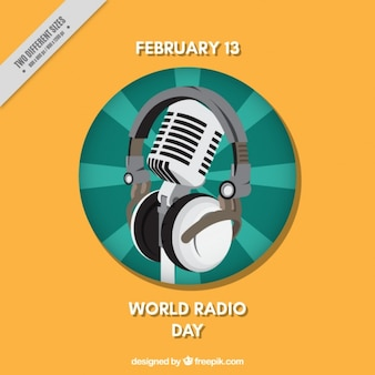 World radio day background with microphone and headphones