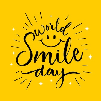 World smile day lettering with happy face