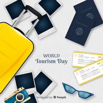 手荷物、パスポート、写真付きの世界観光一日の背景