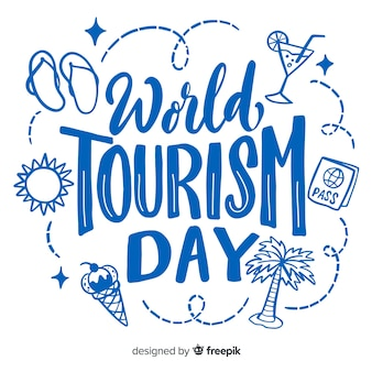 World tourism day lettering with travel items