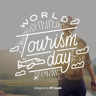 World tourism day lettering with traveler
