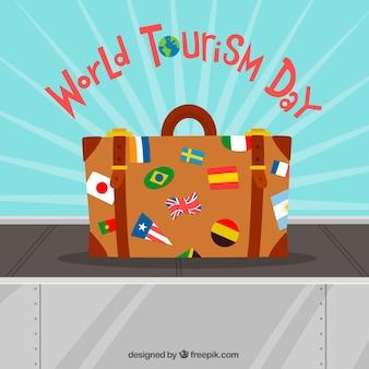 Giornata del turismo mondiale, valigia con bandiere