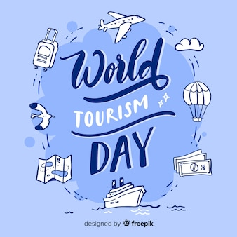 World tourism day with travel items lettering