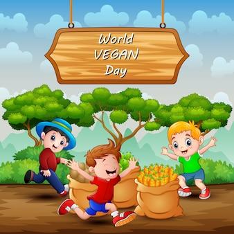 幸せな子供たちが遊んでいるサインの世界ビーガンデー