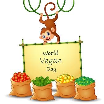 야채와 원숭이 기호에 세계 채식의 날 텍스트 디자인
