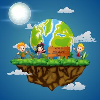 夜のシーンで幸せな子供たちと世界野生生物の日のサイン