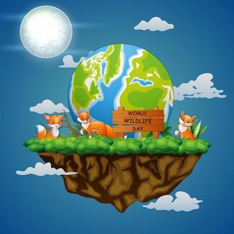 夜の風景に3匹のキツネと世界野生生物の日のサイン