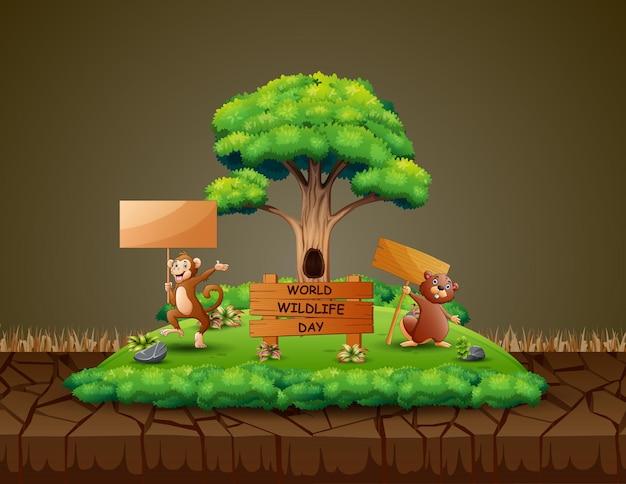 木製の看板を持っている猿とビーバーとの世界野生生物の日