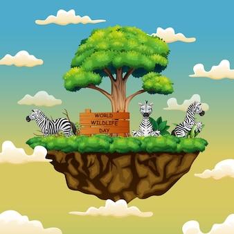 섬에 세 마리의 얼룩말이있는 세계 야생 동물의 날