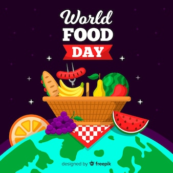 Worldwide food day picnic basket on the globe
