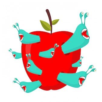 Черви едят красное яблоко.