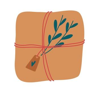 포장된 선물 상자. 태그와 잔가지가 달린 리본으로 묶인 선물이 든 종이 상자