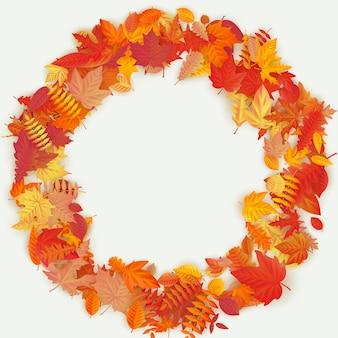 Венок из осенних цветов и листьев на светлом фоне. осенняя композиция.