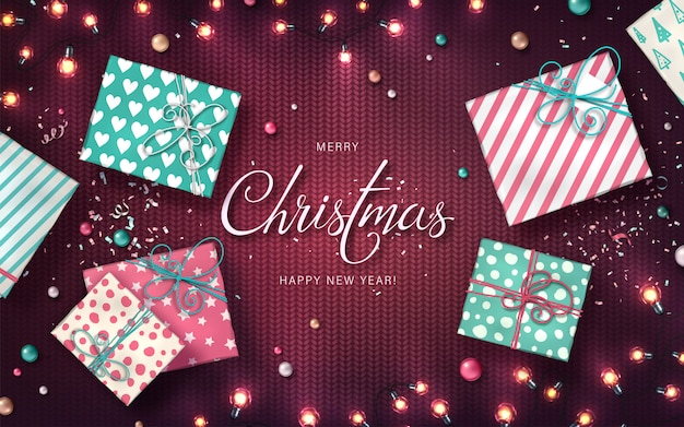Xmas background with christmas lights, baubles, gift boxes and confetti