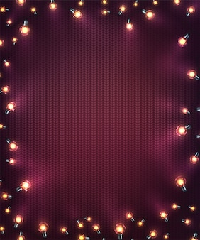 Xmas background with christmas lights. holiday glowing garlands of led light bulbs on knitted texture