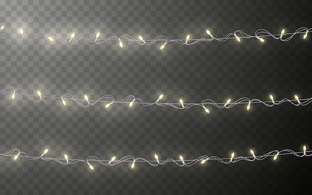크리스마스 색상 화환, 축제 장식. 빛나는 크리스마스 조명 어두운 배경에 투명 효과 장식.