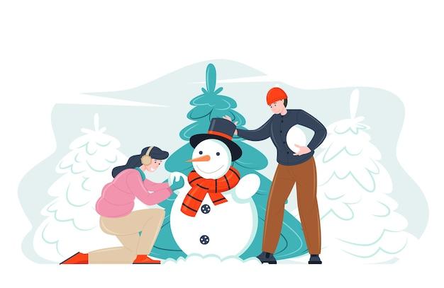 눈사람을 함께 만드는 크리스마스 사람들