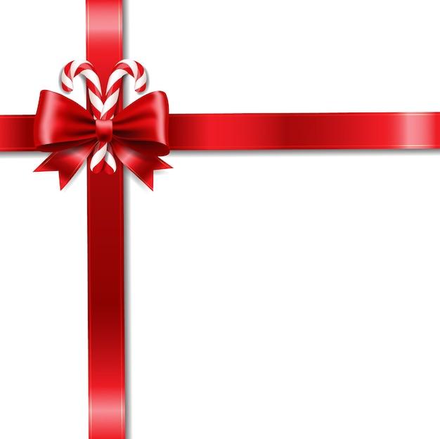 クリスマスリボンの弓とロリポップの白い背景