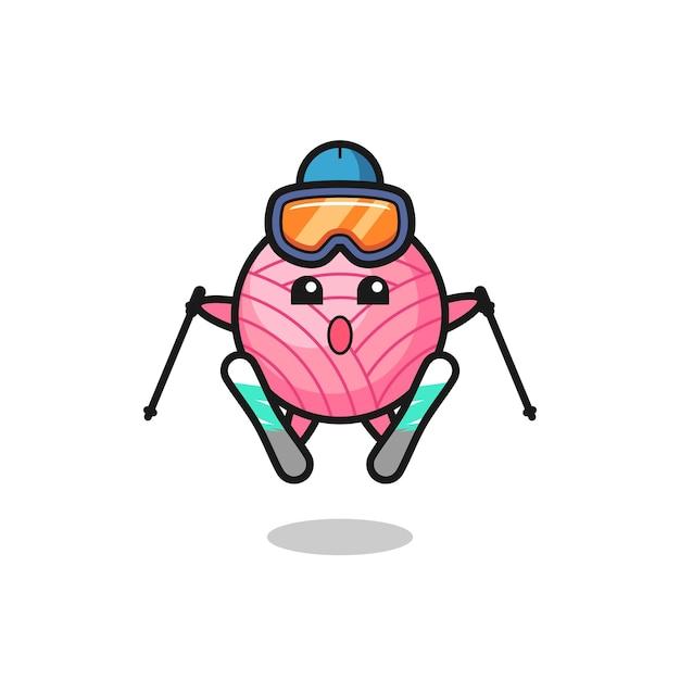 スキー選手としてのヤーンボールマスコットキャラクター、tシャツ、ステッカー、ロゴ要素のかわいいスタイルのデザイン