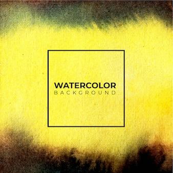 黄色と黒の抽象的な水彩画のしぶきの背景、手描きの紙の上。