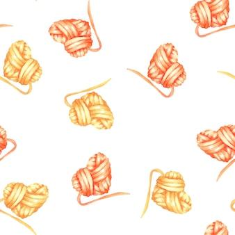 糸パターンの黄色と赤の心臓のボール