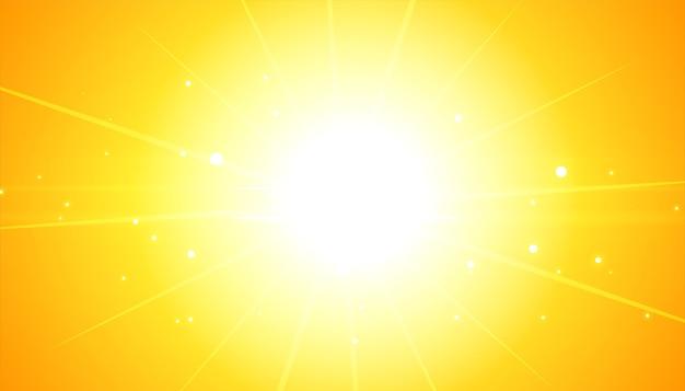 輝くフレア光線と黄色の背景