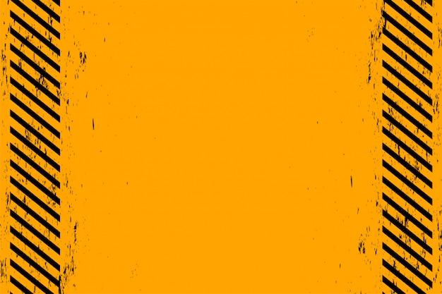 グランジ黒斜めストライプと黄色の背景