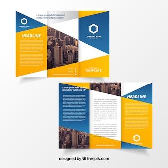Modello brochure giallo e blu trifold