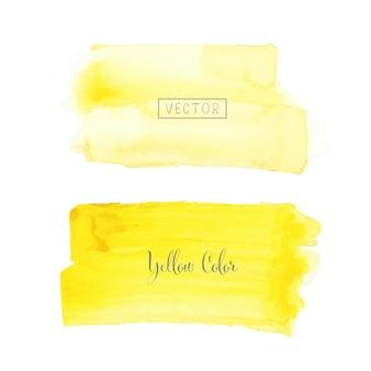 白い背景の上の黄色のブラシストローク水彩画