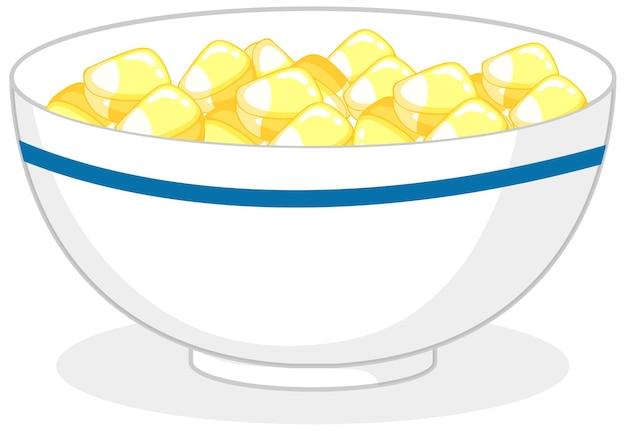 分離されたボウルに黄色いキャンディーやグミ