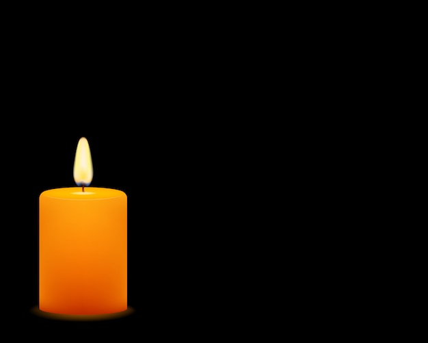 Of yellow candle on black background