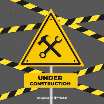 Yellow under construction flat sign