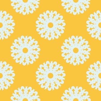 白いヴィンテージの装飾品と黄色の涙にぬれたシームレスパターン。ヴィンテージスタイルのテンプレートの壁紙。インドの花の要素。生地、包装、包装用のグラフィック装飾。