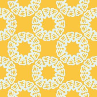 白いヴィンテージの装飾品と黄色の涙にぬれたシームレスパターン。ヴィンテージスタイルのテンプレートの壁紙。インドの花の要素。壁紙、パッケージ、ラッピング用のグラフィックオーナメント。