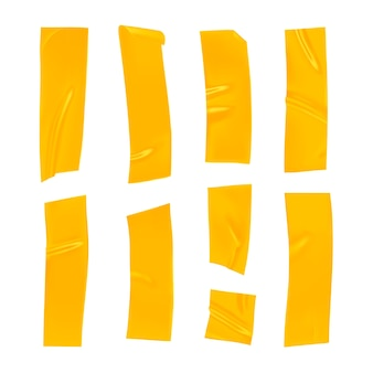Комплект желтой клейкой ленты. реалистичные кусочки желтой клейкой ленты