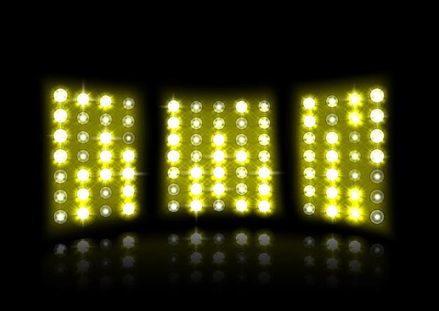 Yellow floodlight of stadium on a dark background