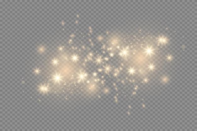 黄色に輝く光が透明な背景で爆発し、魔法のほこりの粒子が明るく輝く...