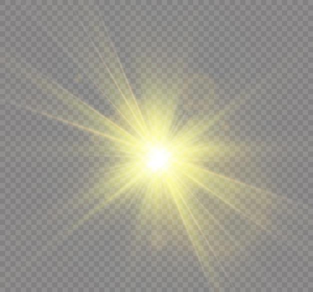 透明な背景に黄色の輝く光が爆発します。きらめく魔法のダスト粒子。輝く星。透明な太陽、明るいフラッシュ。きらめき。明るいフラッシュを中央に配置します。