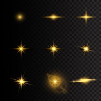 Желтые светящиеся огни и звезды. вспышка солнца с лучами и прожекторами. звезда засияла блеском