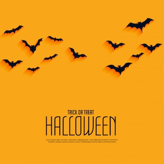 Yellow happy halloween background with flying bats