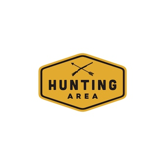 Yellow hunting area sign with crossed gun and arrow
