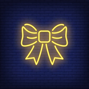 Yellow neon gift bow. night bright sign element. illustration for holiday, present box